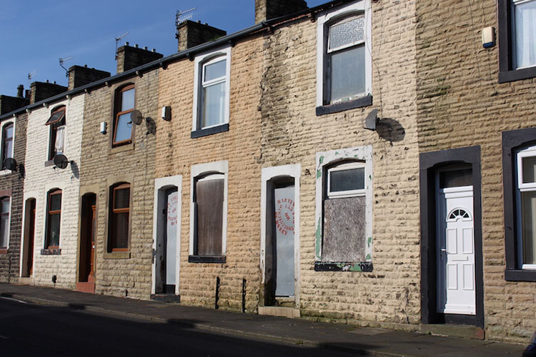 brick houses close to road in Burnley England