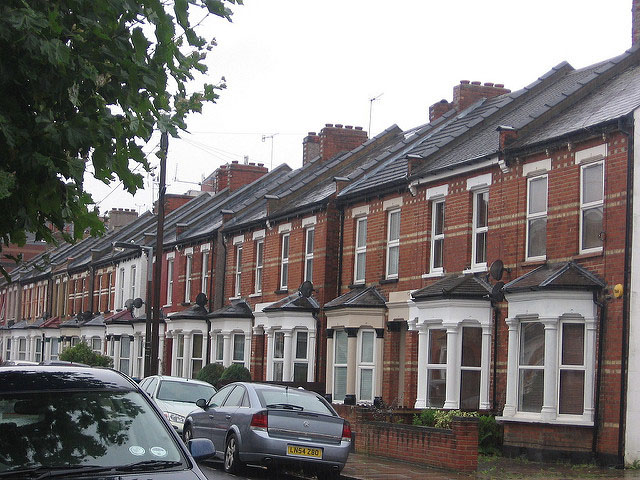 cars on street and terraced house in the United Kingdom